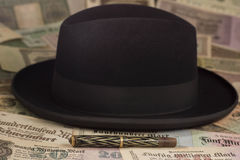 Hat and pen. Black hat and a pen on lots of money Stock Images
