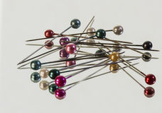 Hat pins on a mirror. royalty free stock photography