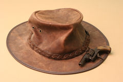 Hat and pistol. Australian hat and antique pistol royalty free stock images