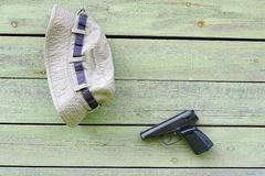 Hat and Pistol on the Wall Stock Photos