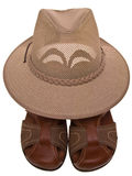 Hat placed on leather sandals Stock Image