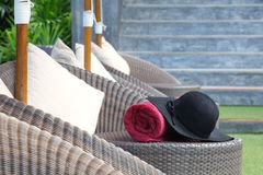 Hat and pool towel Royalty Free Stock Images