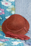 Hat and red gloves. Over a large linen handkerchief Stock Image