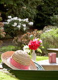 Hat rests on hammock Royalty Free Stock Images