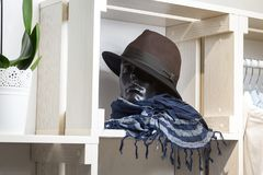 Hat rests on a shelf in a designer store Royalty Free Stock Photography