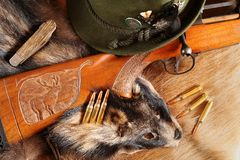 Hat, rifle, bullets and knife on pelt Stock Photography
