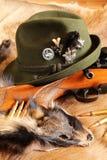 Hat, rifle und bullets on fur Stock Photo