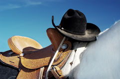 Hat and Saddle. Cowboy hat resting on a saddle during a rodeo Royalty Free Stock Images