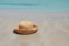 Hat on sand by sea Stock Image