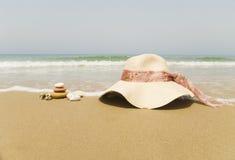 Hat on sandy beach Royalty Free Stock Photos