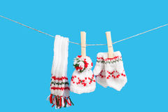 Hat , scarf and pair of gloves drying Royalty Free Stock Photos