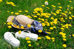 Hat & shoes in meadow Stock Images