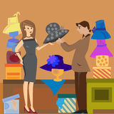 Hat shop. The illustration shows a woman who buys with the help of a clerk in a hat shop Royalty Free Stock Images