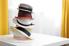 Hat stack on white table in the room Royalty Free Stock Image