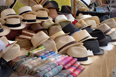 Hat stall. A market stall in Pollenca Mallorca Spain selling straw hats and colorful striped scarves royalty free stock images