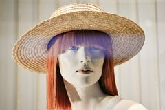 6508bf9ec14d0 The hat is of straw yellow color on the female head of the dummy in the