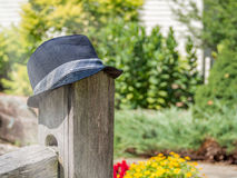 Fedora hat hanging post Royalty Free Stock Images