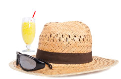 Hat sun glasses and juice Stock Images