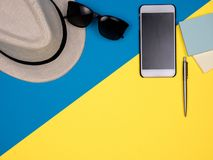 Hat, sun glasses, smartphone, pen and notes stock photo