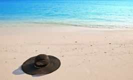 Hat from the sun  lie on sand. Royalty Free Stock Images
