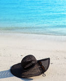 Hat from the sun  lie on sand.Close up in a sunny day Stock Photography