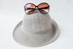 Hat&sunglass. Wooven hat & sunglasses on white background Stock Photo