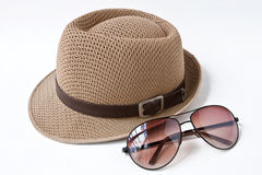 Hat & sunglasses. Wooven hat & sunglasses on white background Stock Images
