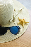 Hat, Sunglasses And Shells Royalty Free Stock Images