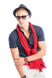 Hat and sunglasses with blue shirt and red scarf and watch Royalty Free Stock Photos