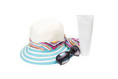 Hat , sunglasses and body lotion Stock Photography