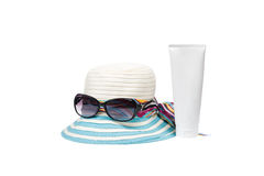Hat , sunglasses and body lotion Royalty Free Stock Image