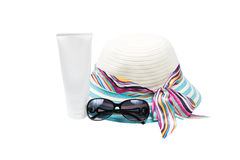 Hat , sunglasses and body lotion Royalty Free Stock Photos