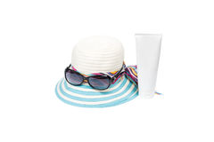Hat , sunglasses and body lotion Stock Images