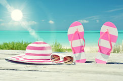 Hat, sunglasses and flip-flops Stock Photo