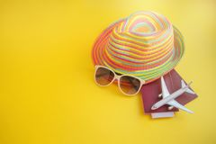 Hat sunglasses passport airplane on yellow background. Travel pl stock photos