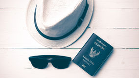 Hat sunglasses and passport vintage style. Hat sunglasses and passport on white table vintage style Stock Image