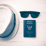 Hat sunglasses and passport vintage style. Hat sunglasses and passport on white table vintage style Stock Photo