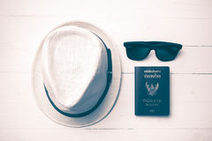 Hat sunglasses and passport vintage style. Hat sunglasses and passport on white table vintage style Royalty Free Stock Photo
