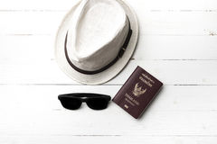 Hat sunglasses and passport Royalty Free Stock Photos