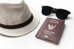 Hat sunglasses and passport Stock Image