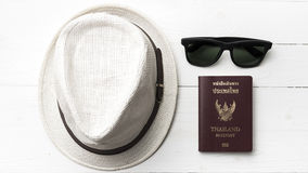 Hat sunglasses and passport Stock Photography