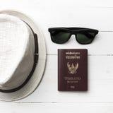 Hat sunglasses and passport Stock Photos