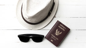 Hat sunglasses and passport Stock Images