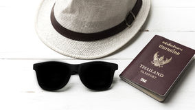 Hat sunglasses and passport Royalty Free Stock Photography