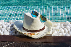 Hat with Sunglasses at the Pool Royalty Free Stock Photography