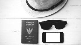 Hat sunglasses smart phone and passport black and white color Royalty Free Stock Image