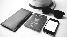Hat sunglasses smart phone and passport black and white color Stock Photos