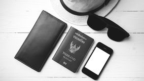 Hat sunglasses smart phone and passport black and white color Royalty Free Stock Photography