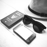 Hat sunglasses smart phone and passport black and white color Royalty Free Stock Photos