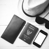Hat sunglasses smart phone and passport black and white color Stock Image